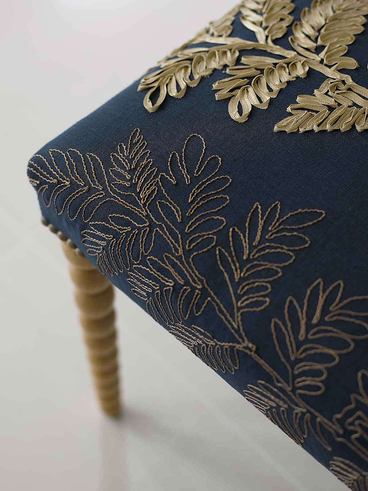 Hand made hallway stool with hand turned bobbin legs and close nailing detail
